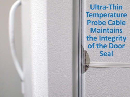 close up of ultra thin temperature probe cable at refrigerator door seal